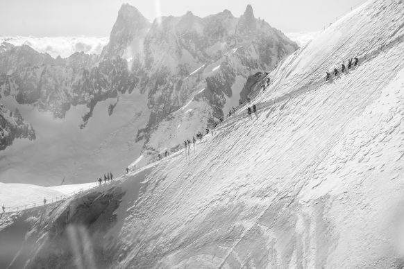 Skiers traversing from the Midi top station to the start of the Valle Blanche