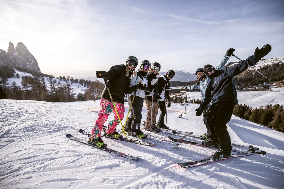 A group of female freeskiers gathers for an exclusive session at Seiser Alm.
